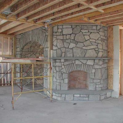 Custom hand laid blue stone fireplace