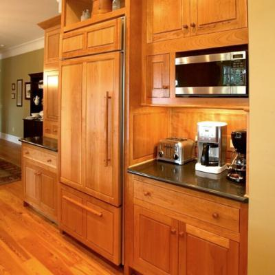 shaker kitchen with cherry paneled refridgerator