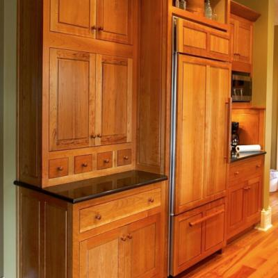 Cherry kitchen with paneled refrigerator