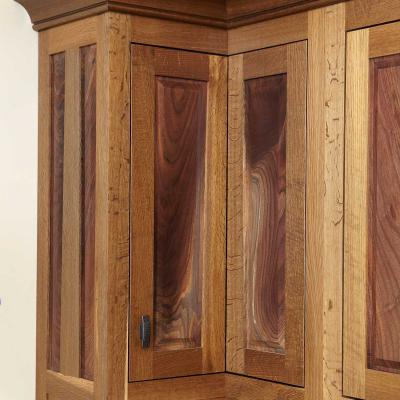 fumed oak and crotched walnut paneled cabinets in Arts & Crafts style