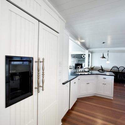 paneled refrigerator cottage kitchen in white